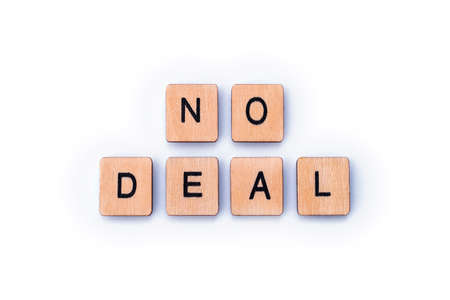 NO DEAL, spelt out with wooden letter tiles.