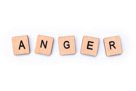 The word ANGER, spelt with wooden letter tiles.