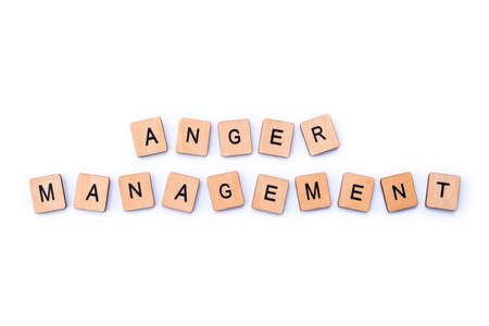 The phrase ANGER MANAGEMENT, spelt with wooden letter tiles.