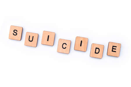 The word SUICIDE, spelt with wooden letter tiles.