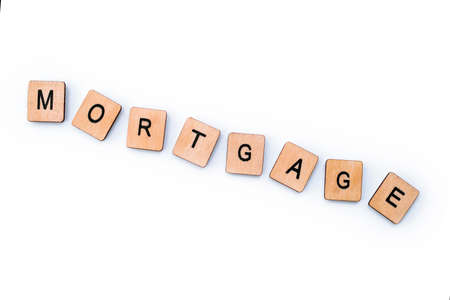 The word MORTGAGE, spelt with wooden letter tiles. Banco de Imagens