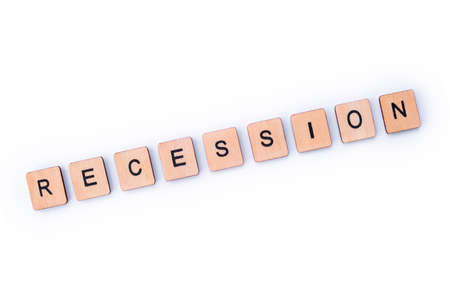 The word RECESSION, spelt with wooden letter tiles. Stockfoto