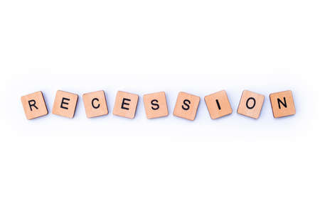 The word RECESSION, spelt with wooden letter tiles.
