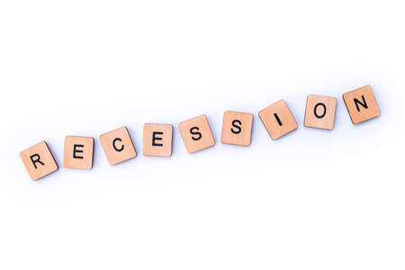 The word RECESSION, spelt with wooden letter tiles. Stock Photo