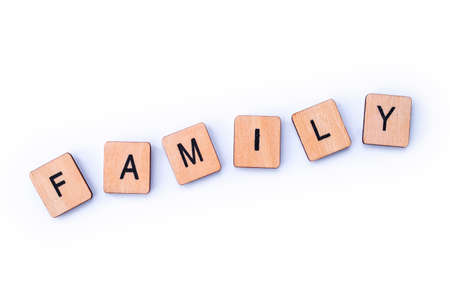 The word FAMILY, spelt with wooden letter tiles.
