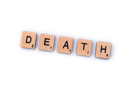 London, UK - February 6th 2019: The word DEATH, spelt out with wooden letter Scrabble tiles.