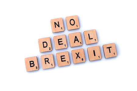 London, UK - February 6th 2019: NO DEAL BREXIT,spelt out with wooden letter Scrabble tiles.
