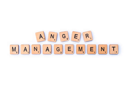 London, UK - February 6th 2019: The phrase ANGER MANAGEMENT, spelt out with wooden letter Scrabble tiles.