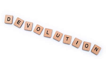 The word DEVOLUTION, spelt with wooden letter tiles over a plain white background.