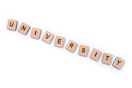 The word UNIVERSITY, spelt with wooden letter tiles on a white background.
