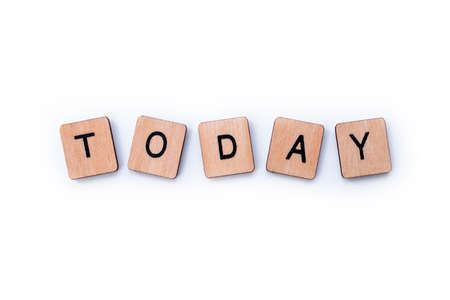 The word TODAY, spelt with wooden letter tiles over a white background.