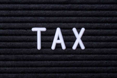 The word TAX, on a letter board.