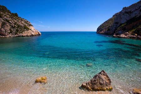A view of the stunning La Granadella beach in Javea, Spain.