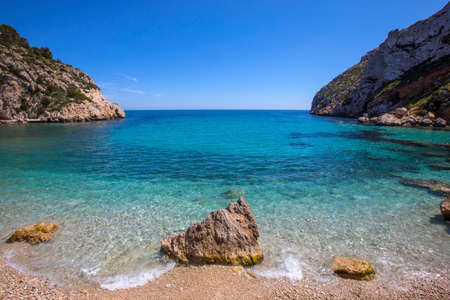 A view of the stunning La Granadella beach in Javea, Spain. Stock Photo