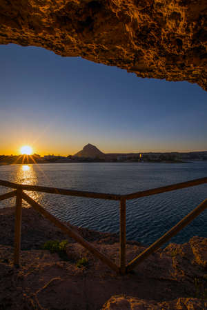 A view at sunset of Montgo Massif and the Arenal beach in the coastal town of Javea in the Costa Blanca, Spain. 版權商用圖片