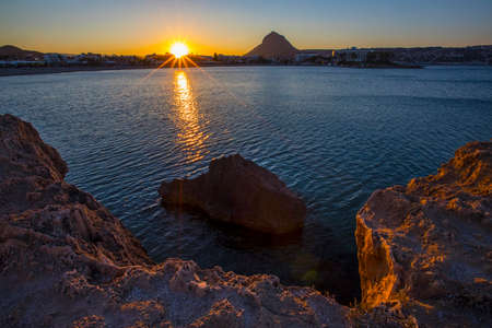 A view at sunset of Montgo Massif and the Arenal beach in the coastal town of Javea in the Costa Blanca, Spain.