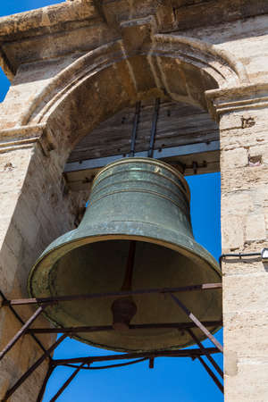 The bell of the historic Torre del Micalet, or El Miguelete - the bell tower of Valencia Cathedral in Spain. Фото со стока