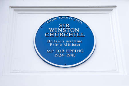 Essex, UK - May 18th 2019: A blue plaque along the High Street in the town of Epping, commemorating Sir Winston Churchill who was the Member of Parliament for Epping, Essex.