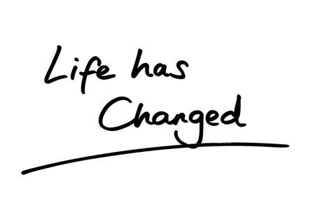 Life has Changed handwritten on a white background.