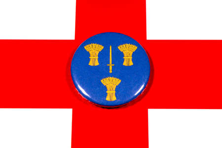 A badge portraying the flag of the English county of Cheshire pictured over the England flag. 写真素材