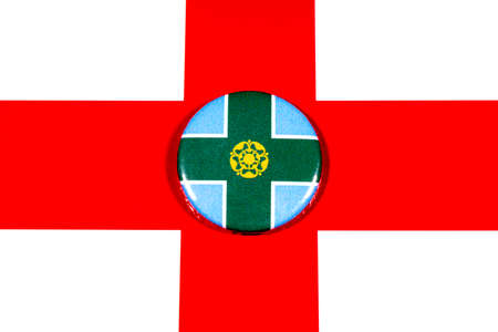 A badge portraying the flag of the English county of Derbyshire pictured over the England flag. 스톡 콘텐츠