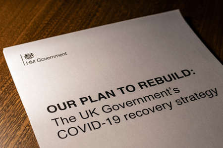 London, UK - May 11th 2020: The front cover of Our Plan To Rebuild - the UK Governments COVID-19 recovery strategy document released on 11th May 2020.
