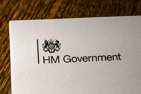 London, UK - May 11th 2020: HM Government logo on the front cover of the document Our Plan To Rebuild - the UK Governments COVID-19 recovery strategy.