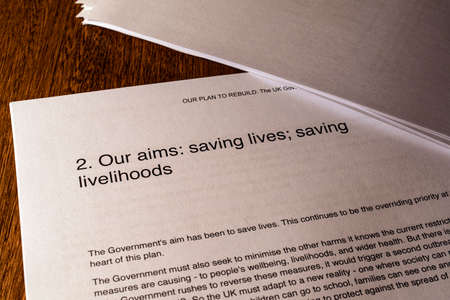London, UK - May 11th 2020: Saving Lives Saving Livelihoods heading in the document Our Plan To Rebuild - the UK Governments COVID-19 recovery strategy.