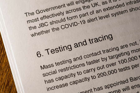 London, UK - May 11th 2020: Testing and Tracing heading in the document Our Plan To Rebuild - the UK Governments COVID-19 recovery strategy.
