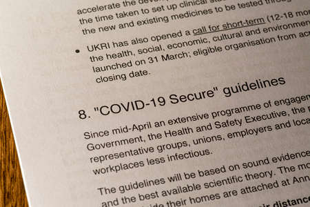 London, UK - May 11th 2020: COVID-19 Secure Guidelines heading in the document Our Plan To Rebuild - the UK Governments COVID-19 recovery strategy.