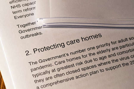 London, UK - May 11th 2020: Protecting Care Homes heading in the document Our Plan To Rebuild - the UK Governments COVID-19 recovery strategy.