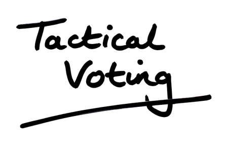 Tactical Voting handwritten on a white background. Foto de archivo