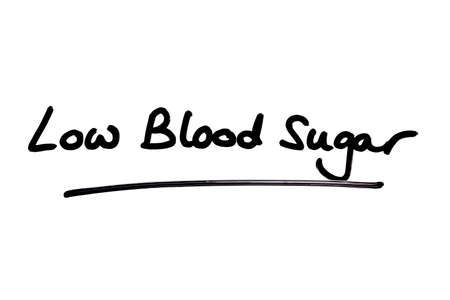 Low Blood Sugar handwritten on a white background. Standard-Bild