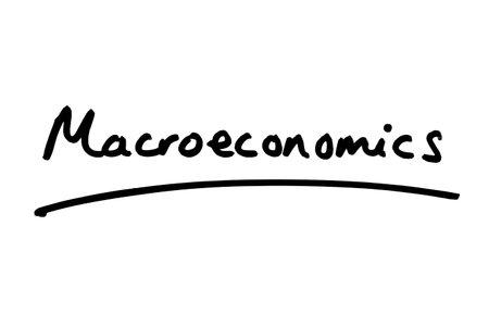 Marcoeconomics handwritten on a white background. 版權商用圖片