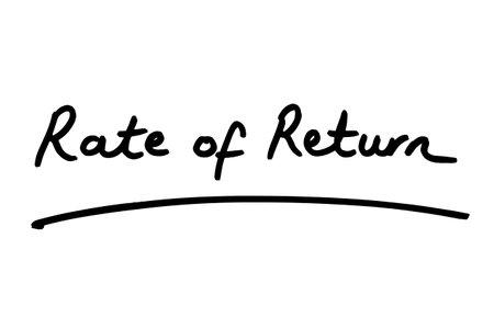 Rate of Return handwritten on a white background. 版權商用圖片
