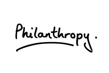 The word Philanthropy handwritten on a white background.