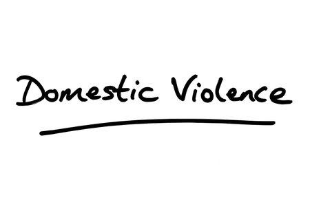 Domestic Violence handwritten on a white background. Zdjęcie Seryjne