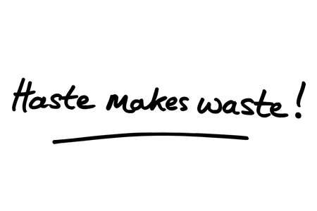 Haste makes waste! handwritten on a white background. Standard-Bild