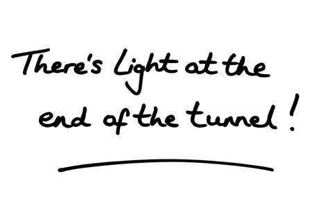 Theres Light at the end of the tunnel! handwritten on a white background.