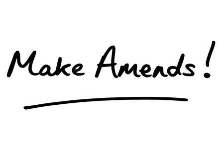 Make Amends! handwritten on a white background. Standard-Bild