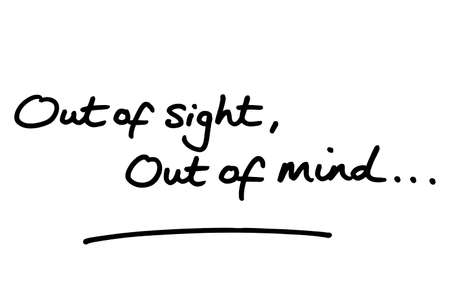 Out of sight, Out of mind… handwritten on a white background.