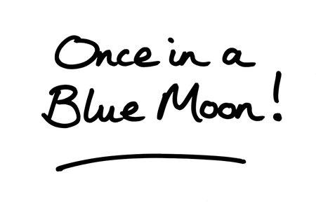 Once in a Blue Moon! handwritten on a white background. Standard-Bild