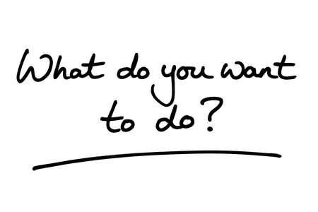 What do you want to do? handwritten on a white background. Standard-Bild
