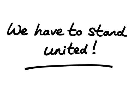 We have to stand united! handwritten on a white background. Standard-Bild