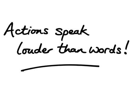 Actions speak louder than words! handwritten on a white background.