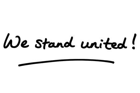 We stand united! handwritten on a white background. Standard-Bild