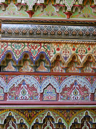 Closeup richly patterned multicoloured, handpainted Moroccan furniture