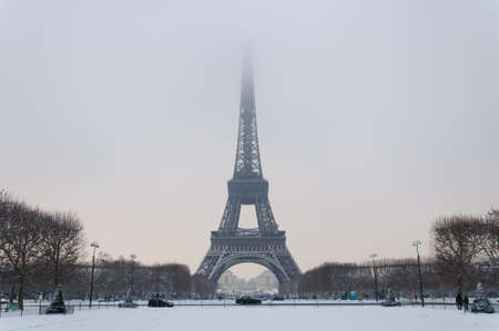 The Eiffel tower with the head in the clouds