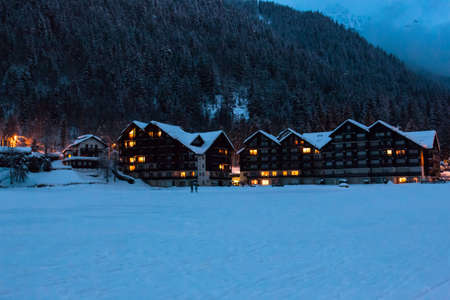 Beautiful chalets by night in the middle of the Alps. Snowing time.