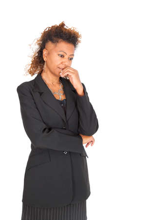 Beautiful black businnesswoman doing different expressions in different sets of clothes photo